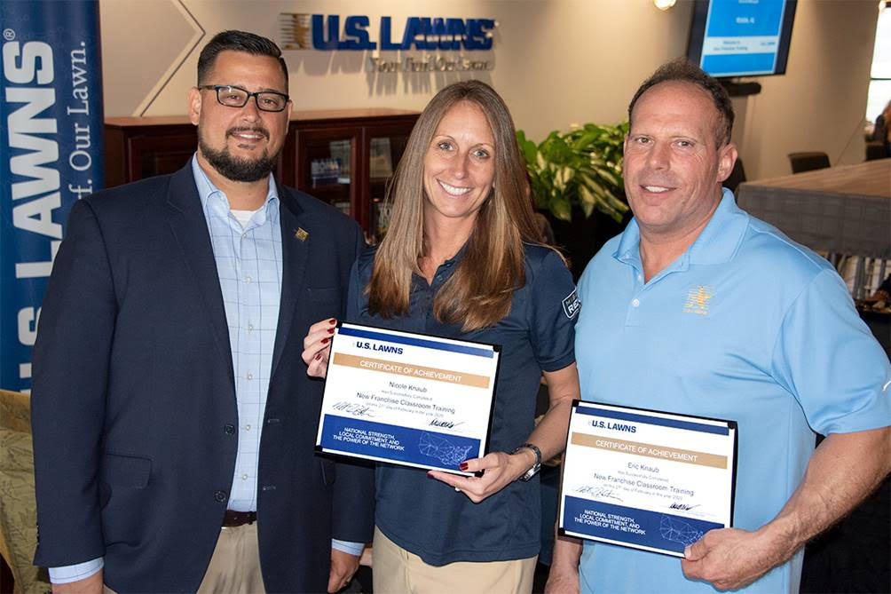 David Wells (left) pictured with two new U.S. Lawns franchisees
