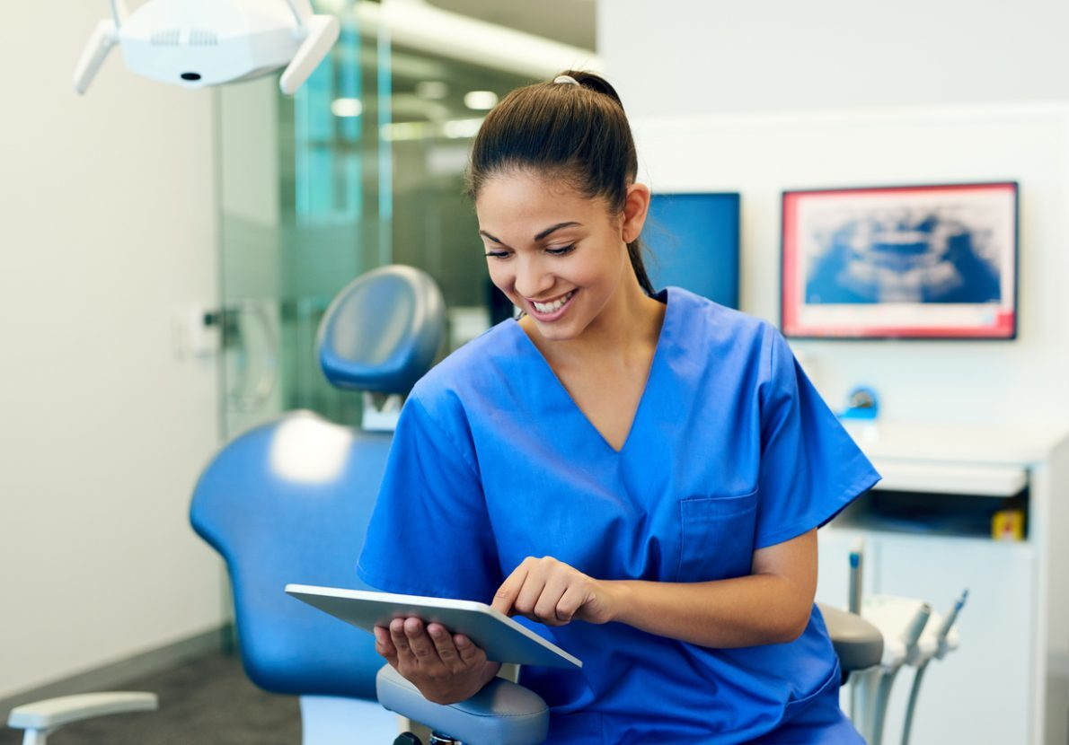 Dentist looking at patient records